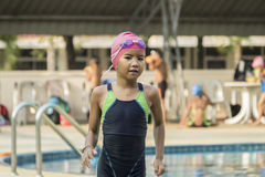 Little girl run at swimming pool side Royalty Free Stock Photography