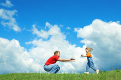 Little Girl Run To Mother Embrace On Green Grass Stock Image