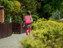 Little girl  run to school Stock Images
