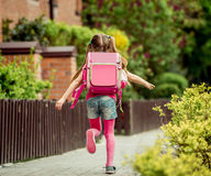 Little girl  run to school Royalty Free Stock Image
