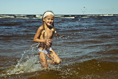 Little girl runing Stock Photos