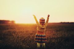 Little girl runnig to the sunset royalty free stock photography