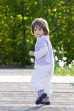 Little girl running Stock Images