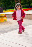 Little girl running Royalty Free Stock Photos