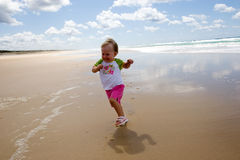 Little girl running Stock Image
