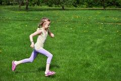 Little girl running Stock Photo