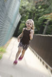 Little Girl Running Stock Photography