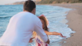 Little girl running along the beach to her father. Little girl in sundress running along the beach to her father in slow motion stock video footage