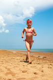 Little girl running along ocean Royalty Free Stock Photo