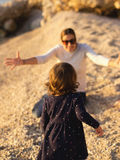 Little girl running into the arms of mom Royalty Free Stock Photo