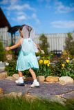 Little girl running around with wings on his back Stock Photos