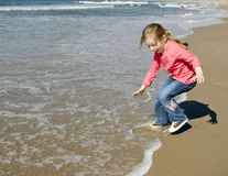 Little girl running away Stock Images