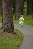 Little girl running away Stock Photos