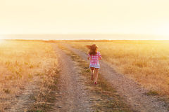 Little girl running in backlit meadow Royalty Free Stock Photography