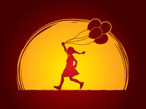 Little girl running with balloons Royalty Free Stock Photography