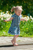 Little girl running barefoot Royalty Free Stock Photo