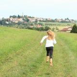 Little girl running barefoot Royalty Free Stock Photos