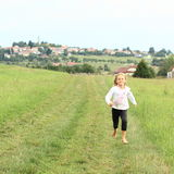 Little girl running barefoot Royalty Free Stock Photo