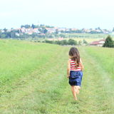 Little girl running barefoot Stock Image