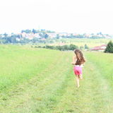 Little girl running barefoot Stock Photos