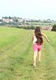 Little girl running barefoot Royalty Free Stock Image