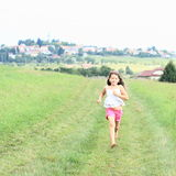 Little girl running barefoot Royalty Free Stock Photos
