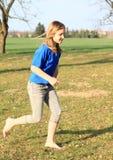 Little girl running barefoot Stock Images