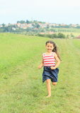 Little girl running barefoot Royalty Free Stock Photography