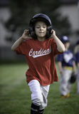Little girl running the bases. In the baseball game royalty free stock image