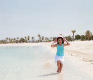 Little girl running on the beach Royalty Free Stock Photo