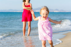 Little girl running on the beach Royalty Free Stock Photography