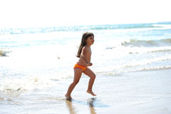 Little girl running on the beach. Stock Photography