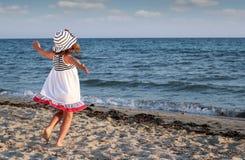 Little girl running on beach Royalty Free Stock Photo