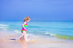 Little girl running on a beach Royalty Free Stock Photography