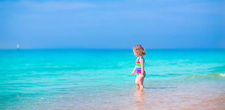 Little girl running on a beach Stock Image
