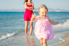 Little girl running on the beach Royalty Free Stock Image