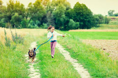 Little girl running with dog stock image