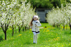 Little girl running in the garden Stock Photo