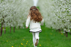 Little girl running in the garden Stock Image