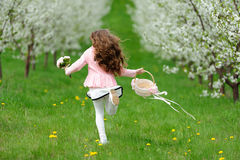 Little girl running in the garden Stock Photography