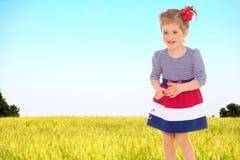 Little Girl running in grass Stock Photos