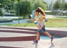 Little girl is running Royalty Free Stock Image