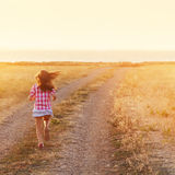 Little Girl Running In Backlit Meadow Royalty Free Stock Photo