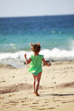 Little girl running on Lanzarote beach Royalty Free Stock Photos
