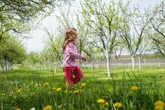 Little girl running Royalty Free Stock Image