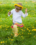 Little girl running  on a meadow Royalty Free Stock Photography