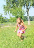 Little girl running on meadow Royalty Free Stock Image