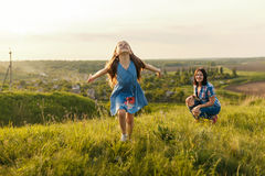 Little girl running on meadow Stock Image