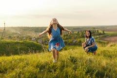 Little girl running on meadow Stock Image