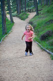 Little girl running outdoor at the mountain Royalty Free Stock Images